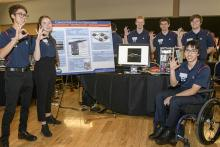UA Engineering Design team students display their design project