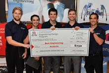 Team 15098 presents their big check for Best Engineering Analysis at Design Day 2016