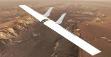 Computer-generated, photo-realistic depiction of a glider flying over the surface of Mars.