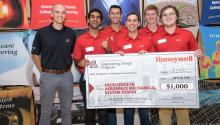 Students holding a large check