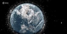 An animated rendering of Earth shows it in space, surrounded by debris.