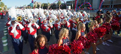 UA Homecoming Parade featuring pom squad and marching band