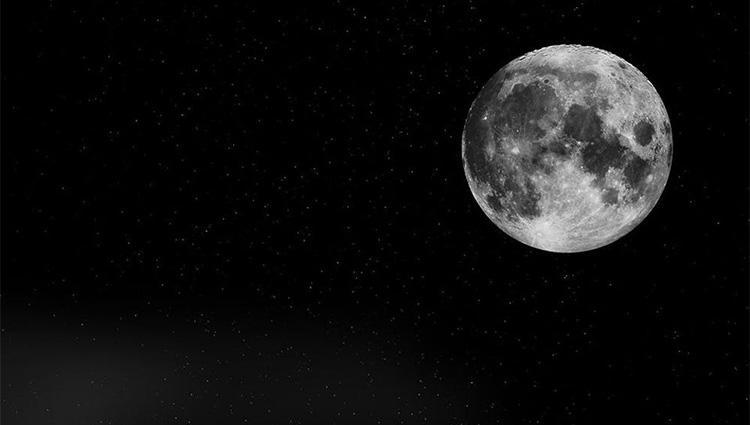 The moon against a black sky