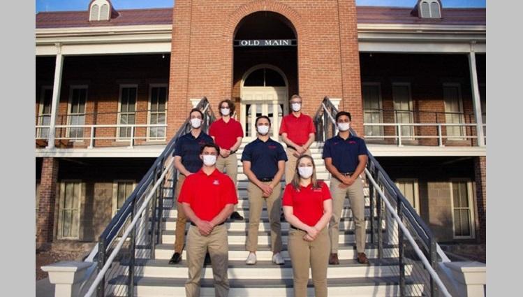 Team LAVA stands on university steps